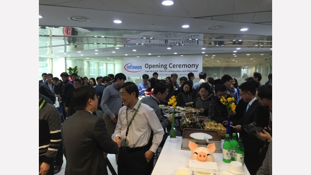 Management and employees coming together to celebrate the expansion of our Korean office space