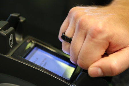 The world's first EMVCo compliant payment ring is based on a contactless security chip from Infineon Technologies AG. The tiny, water-proof smart wearable works like a contactless payment card. Users can pay by simply holding their finger with the ring closely to any EMVCo contactless-enabled payment terminal.