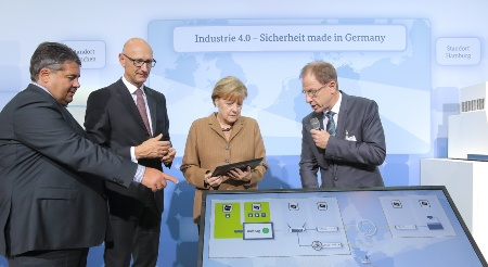 "Infineon Technologies AG and Deutsche Telekom AG today presented a security solution for the protection of networked production on occasion of the ""Nationaler IT-Gipfel 2014"" in Hamburg. From left to right: Sigmar Gabriel, Federal Minister for Economic Affairs and Energy, Timotheus Höttges , CEO Deutsche Telekom, Federal Chancellor Angela Merkel, Reinhard Ploss, CEO Infineon Technologies."