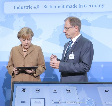 "Infineon Technologies AG and Deutsche Telekom AG today presented a security solution for the protection of networked production on occasion of the ""Nationaler IT-Gipfel 2014"" in Hamburg. From left to right:Federal Chancellor Angela Merkel, Reinhard Ploss, CEO Infineon Technologies. ©Frank Ossenbrink"